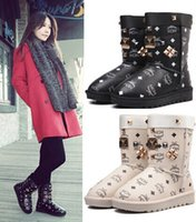 Wholesale High quality PU winter MCM Lady snow boots with metal rivets women s boots slip printing plus Students Boots