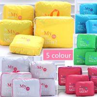 Wholesale 2015 Fashion colors Waterproof Bag Home Travel Nylon Storage Bag Pieces Women Luggage Travel Bags