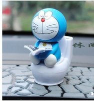 Wholesale Auto Car Interior Decoration Solar Energy Four Facial Expressions Funny Head Shaking Doraemon Reading Books on Toilet Dolls Toys