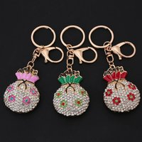 Wholesale Aureate Lucky Bag Pendant Flower Key Ring Key Chain Fashional Jewelry Hollow Rhinestone Car Keychain Women Bag Pendant Gift J0500