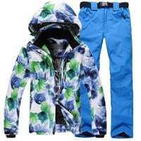 Wholesale women shooded print ski jacket and solid pant waterproof windproof and warm ski and snowboard suit for women