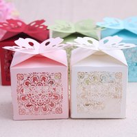 red heart candy - 2015 New Cut Love Heart Laser Gift Candy Boxes Elegant Butterfly Wedding Party Favor box With Ribbon white red blue pink