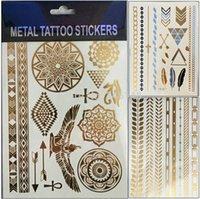 al por mayor tatto-5pcs mixta / papel tatoo lotgold temporales alas etiqueta del arte de mujeres hombres cuerpo dorado tatto pluma de pájaro pegatinas tatuaje temporal metálica