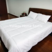 Wholesale White polyester TC plain peach skin comforter quilt twin size