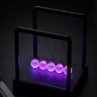 antique glass lighting - 2015 new LED Newtons Cradle Balance Balls Desk Science Toy Gift Kinetic Light
