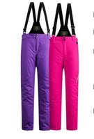 Wholesale Women Skiing pants Winter skiing suit New Waterproof warm women ultra breathable straps ski pants Two colors retail and