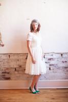 Wholesale Stunning Short Sleeve Wedding Dresses Backless vestido de novia Bow Sheer Lace Tea Length V Neck Stunning Ball Gown Bridal Custom Made