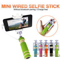 Wholesale Four generations of ultra small mini pocket palm sized remote control integrated with the self stick foam hand sets Self pole line