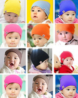 Wholesale Solid color newborn hat comfortable wear soft cotton baby cap fourteen colors per