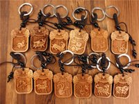 Wholesale trendy wood key chain keychain rabbit pig tiger dragon car key ring christmas gift men women key holder for the keys