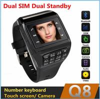 Wholesale Dual SIM GSM Q8 mobile smart watch phone Mp camera bluetooth touch screen keyboard MP3 MP4 Radio unlock