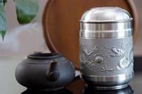 Wholesale Professional big mouth Shuanglongxizhu supply pattern tea pot metal crafts tea packaging