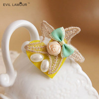 Wholesale new new small pure and fresh and lace starfish bowknot pearl brooches