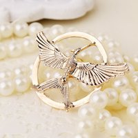 Wholesale New European film blockbuster Hunger Games parrot brooch brooch Bird Bird laugh