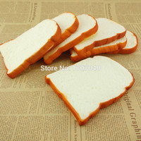 Wholesale Jumbo Squishy Sliced Toast Toy Soft Bread Scented Funing Hand Pillow Gift Home Kitchen Decoration