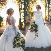 wedding dresses long sleeved - Gorgeous Arabic Wedding Dresses Long Sleeved Sexy Backless Bridal Gowns Sheer Bateau Neckline Lace Peplum Oversize Bow Sweep Train Plus Size