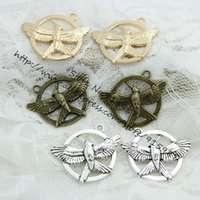 antique game pieces - pieces mm Three Colors Plated Antique Metal Alloy The Hunger Game Charms Fit Jewelry Making Charms D0374
