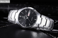 Wholesale new calendar upscale casual men s fashion tungsten steel watches black and white female couples piece