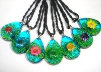 al por mayor resina colgantes de flores reales-Moda real presionado flor ámbar colgante collar de resina colorido Brasil poco colgante de flor de estrella con fondo azul