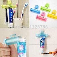 Wholesale Creative Rolling Squeezer Toothpaste Dispenser Tube Partner Sucker Hanging Holder Color Random Drop T1240 W0