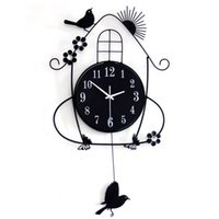 Wholesale Long reach factory direct living room bedroom artistic wrought iron wall clock bird swing creative wall clock