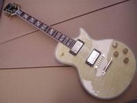 Wholesale supreme electric guitar mahogany body neck top quality in cream burst