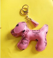 Wholesale 2014 mcm small gifts women dog leather keychain fashion brands key chain tiny gifts mcm small bags