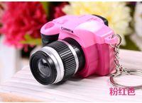 Wholesale SLR lens camera car accessories bag pendant keychain LED luminous voice