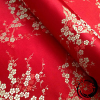 Wholesale fabric Ancient Chinese wind plum flower fabric DIY doll dress hanfu COS thick satin material red background painstakingly