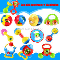 Wholesale 5pcs High quality Lovely Plastic Baby Toy Gutta percha Hand Shake Bell Ring Rattles toys Educational Colorful Safe