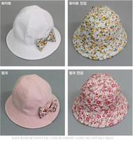 flower bucket hats - 2015 Spring Autumn new baby girls sun hat bowknot newborn bucket hat korean style Small broken flower infant caps Double sided wear ab1056