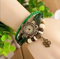 achat en gros de bracelet en cuir de trèfle gros-Drop shipping Montres de poignet vintage coréenne Clover Pendentif main tissé bracelet en cuir bracelet Montre de quartz analogique femmes en bronze de gros