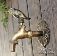 Wholesale TB9034 Decorative outdoor faucets Wall mounted brass animal garden Bibcock with rural style antique bronze bird tap