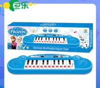 Instrumentos Musicales Cartoon congelados niños de juguete Muchacha congelada Juguete Organo de dibujos animados electrónico Teclado bebé Electronic Piano con música 8 canciones