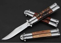 Wholesale butterfly knife CAT Color wood handle knife to practice
