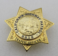 antique traffic light - United States emblem of the California TRAFFIC OFFICER CHP badge on the highway