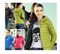 Wholesale Nuevo para mujer de moda diseño hacia abajo capa corta de algodón acolchado de invierno mujeres sólido cremallera prendas de vestir ext