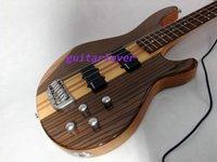 Custom Shop 4 cuerdas Bajo eléctrico de madera zebral Bajo eléctrico 5 piezas Cuello Guitarras al por mayor