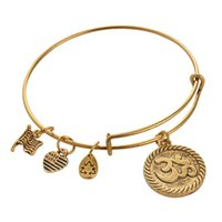 alloy steel outlets - Alex Ani OM Gold Charm Bangle Antiqued Style Expandable Steel Wire Bracelets Pulseiras Fashion Jewelry Factory Outlet