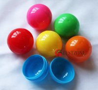 Wholesale Plastic lucky draw balls or toy capsules solid multicolors separating two parts open and close diameter mm