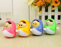 Wholesale high quality wind up clockwork smiley Russian doll gift toy