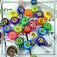 Wholesale Smiling face id badge holder Badge reels retractable id card reels with custom logo