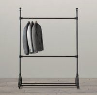 wood display - French country furniture wrought iron LOFT American Apparel clothing store shelf display hanger pulley