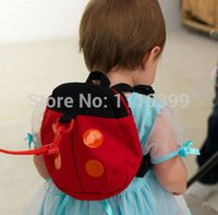 Wholesale Anti lost baby ladybug bag baby bag with anti lost packets can be turned children school bags