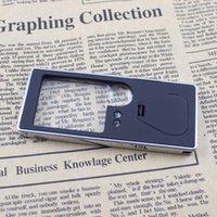 achat en gros de verres d'argent-Multifonctionnel 3X / 10X Loupe de Mobile Card Design avec 4 lumières LED UV 1 argent Détection Mini Pen outil Loupe E0298