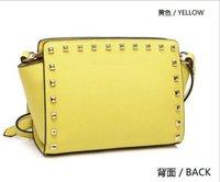 Wholesale Fashion leather small smiley face trapeze bags women rivets handbags famous brands shoulder messenger bags ladies bolsos marca
