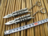 features - THE ONE Mini Keychain Balisong Butterfly knife with Rivet Feature Silver Novelty knife Made of stainless steel