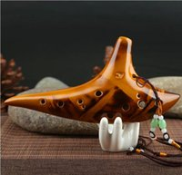Wholesale 12 Holes Ocarina Alto Voice Smoldering Kiln fired Ceramic Submarine Shape Ocarina with Ocarina Pouch