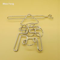 Wholesale Octopus Ring Solution Metal Puzzle Magic Gadget Fun Fish Wire Puzzle Games Brain Teaser