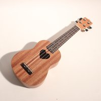 Wholesale 21 inches quality mahogany four strings Hawaii ukulele with sound hole in the shape of heart Hawaii small guitar